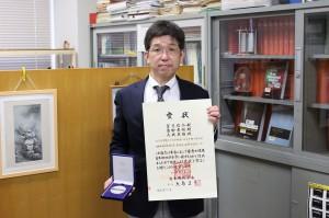 受賞の望月信介教授